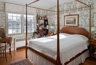 Traditional Guest Bedroom with Laminate floors, High ceiling, interior wallpaper