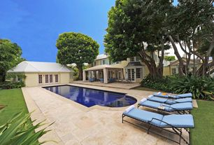 Traditional Swimming Pool with exterior stone floors, French doors