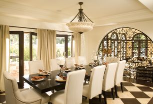 Mediterranean Dining Room with Crown molding, specialty door, French doors, Built-in bookshelf, flush light