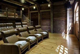 Country Home Theater with can lights, Loft, Exposed beam, Standard height, Glass panel door, Hardwood floors, Pendant light