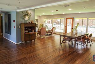 Modern Living Room with Built-in bookshelf, specialty door, Laminate floors