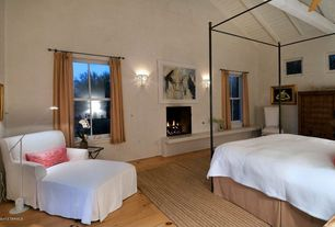 Eclectic Master Bedroom with Exposed beam, High ceiling, Wall sconce, Ceiling fan, Hardwood floors