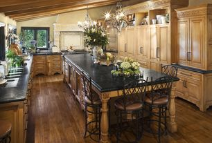 Traditional Kitchen with High ceiling, Kitchen island, Raised panel, Exposed beam, Breakfast bar, Custom hood, Natural light