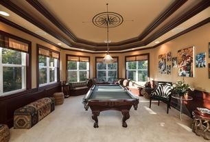 Traditional Game Room with Window seat, Crown molding, Carpet, Standard height, Chair rail, double-hung window, can lights