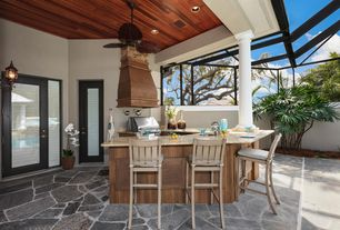 Tropical Patio with Doric column, Trellis, Fence, exterior stone floors, Outdoor kitchen, Paint, Simple granite counters