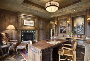 Rustic Home Office with six panel door, Built-in bookshelf, Fireplace, flush light, Wall sconce, Hardwood floors, can lights