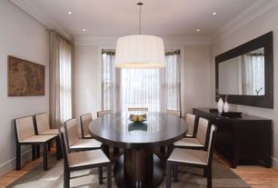 Contemporary Dining Room with flush light, Hardwood floors, Built-in bookshelf, Crown molding