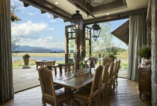 Country Dining Room with Indoor/outdoor living, flush light, High ceiling, Laminate floors