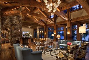 Rustic Great Room with Arched doorway, Hickory - sunset sand 5 in. engineered hardwood wide plank, Stacked stone wall