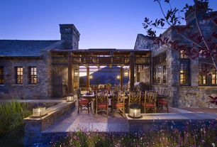 Rustic Patio with exterior stone floors, Outdoor kitchen, Pathway