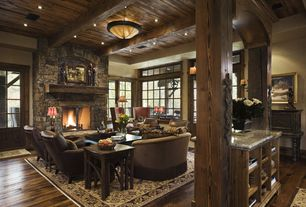 Rustic Living Room with stone fireplace, Exposed beam, French doors, Restoration hardware parisian leather chair, flush light