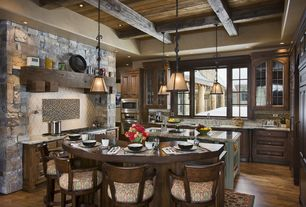Rustic Kitchen with Wood counters, Pendant light, Custom hood, Exposed beam, Large Ceramic Tile, Simple granite counters