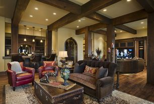 Eclectic Great Room with Studded leather armchair, Tufted sofa, Trunk coffee table
