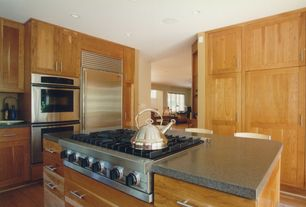 Modern Kitchen with Kitchen island, L-shaped, Built In Refrigerator, Concrete counters, Glass panel, Flush, can lights