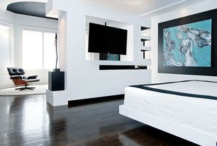 Contemporary Master Bedroom with Laminate floors, High ceiling