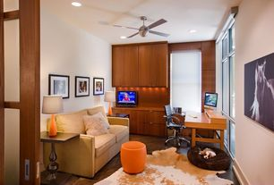 Contemporary Home Office with Built-in bookshelf, picture window, Standard height, Ceiling fan, can lights, Hardwood floors