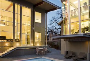 Contemporary Exterior of Home with Transom window, French doors, Fence, exterior stone floors, picture window