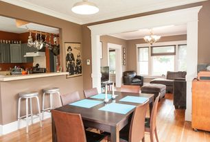 Craftsman Dining Room with Laminate floors, flush light, double-hung window, Standard height