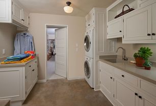 Traditional Laundry Room with Concrete floors, Built-in bookshelf, flush light