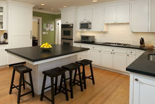 Traditional Kitchen with Undermount sink, Black saddle seat stool, Flat panel cabinets, U-shaped, Crown molding, Glass panel