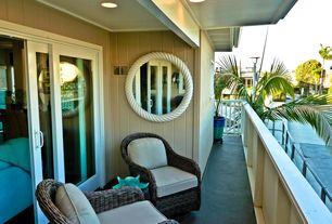 Tropical Patio with Recessed lighting, Balcony, Deck Railing, Paint, can lights, exterior tile floors, sliding glass door