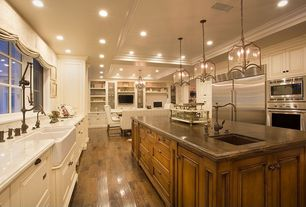 Traditional Kitchen with Complex marble counters, Pental african ivory polished granite, Crown molding, Wood counters