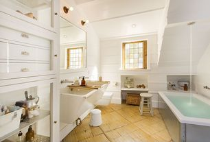 Cottage Master Bathroom with Bidet, Wall mounted sink, Inset cabinets, Master bathroom, Brick floors, Glass panel