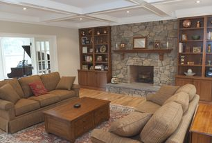 Traditional Living Room with French doors, stone fireplace, Hardwood floors, Built-in bookshelf, Crown molding, Box ceiling