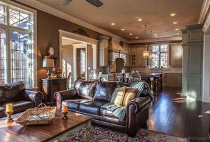 Traditional Great Room with Ceiling fan, High ceiling, Laminate floors, Pendant light, Crown molding