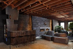 Rustic Bar with Natural stone faced fireplace, Exposed beam, Custom bar with acid treated steel countertops, Carpet