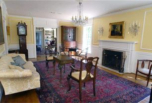 Traditional Living Room with Chandelier, Laminate floors, Wainscotting, Crown molding, Wall sconce, Cement fireplace