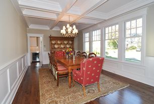 Cottage Dining Room with Laminate floors, Wainscotting, double-hung window, High ceiling, Chandelier, Box ceiling
