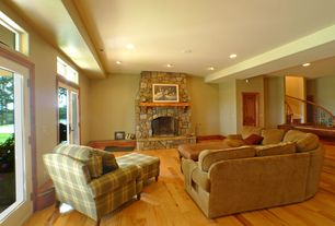 Contemporary Family Room with six panel door, French doors, Standard height, Fireplace, Hardwood floors, stone fireplace