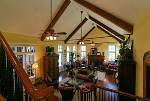 Traditional Living Room with French doors, Fireplace, High ceiling, double-hung window, Ceiling fan, Chandelier, Casement