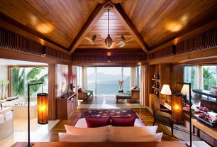 Tropical Master Bedroom with Ceiling fan, Wood panel ceiling