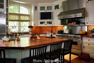 Traditional Kitchen with Complex granite counters, Glass panel, Wood counters, Flat panel cabinets, Arched window, L-shaped