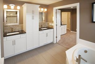 Traditional Master Bathroom with Double sink, specialty door, Pental Sign Porcelain Tile, Soapstone counters, Flush
