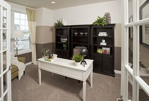 Traditional Home Office with can lights, Built-in bookshelf, Standard height, Carpet, French doors, Casement