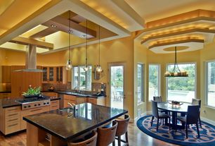 Contemporary Kitchen with Breakfast bar, L-shaped, Pendant light, Chandelier, Undermount sink, Stone Tile, two dishwashers