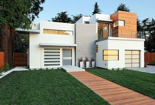 Contemporary Exterior of Home with Ipe decking, Cable railing system