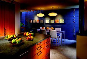 Modern Dining Room with Built-in bookshelf, Standard height, can lights, Concrete floors, flush light