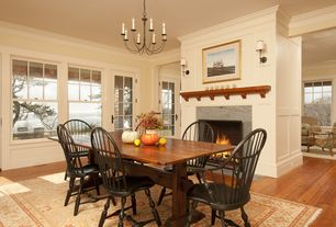 Country Dining Room with Wall sconce, Standard height, Chandelier, brick fireplace, Natural light, Crown molding, Fireplace