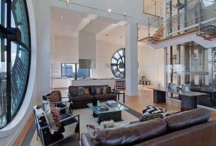 Contemporary Great Room with Hardwood floors, Cow hide chair, Leather sofa, Square glass coffee table, Pendant light, Loft