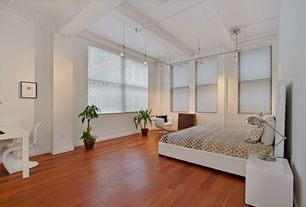 Contemporary Master Bedroom with Hardwood floors, Exposed beam