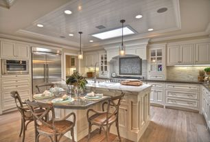 Traditional Kitchen with Eat in kitchen, Elk lighting genevieve single-light polished chrome pendant, Crown molding, Skylight