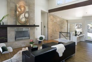 Contemporary Living Room with Rock and stone 3d white limestone roughcut, Hardwood floors, French doors, metal fireplace