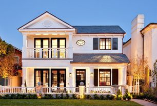 Traditional Exterior of Home with Fenced deck, Decorative shutters