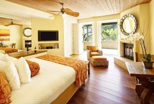Eclectic Master Bedroom with Hardwood floors, Pottery Barn Belgian Linen Flax Quilt - White, Ceiling fan, Louvered door