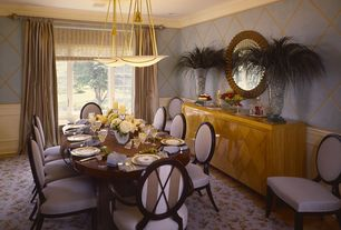 Traditional Dining Room with Crown molding, Laminate floors, High ceiling, interior wallpaper, Pendant light