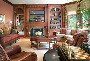 Traditional Living Room with Wall sconce, picture window, One kings lane - palmetto hexagonal ottoman, Built-in bookshelf